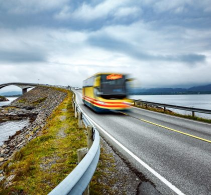 "Public bus traveling on the road in Norway. Public bus in motion blur. Atlantic Ocean Road or the Atlantic Road (Atlanterhavsveien) been awarded the title as ""Norwegian Construction of the Century""."